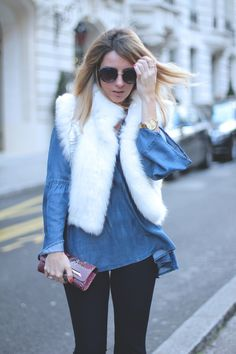 70'S LOOK IN PARIS Street style with fur vest by fashion blogger