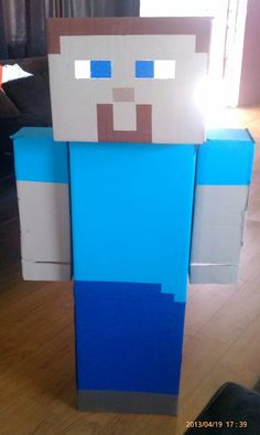 Minecraft Steve - made with cardboard boxes,  hot glue gun, and acrylic paint.