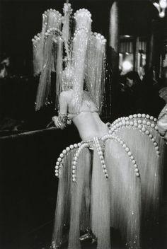 A showgirl at The Folies-Bergeres in Paris, 1960, photo by Edouard Boubat