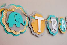 Elephant Name or It's a Boy Banner Turquoise Yellow and Gray Baby Shower Birthday Banner Baby Boy. $22.50, via Etsy.