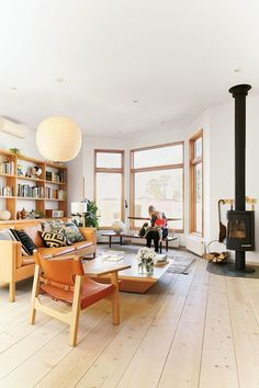 living room; love the light and the warm colors of chair and sofa