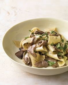 Pungent Taleggio cheese makes a creamy coating for this decadent dish when tossed with warm mushrooms and pasta. You can also use brie, which is milder in flavor.