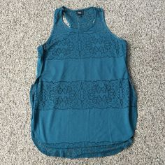 Cute summer top Cute summer top with lacy cut outs.  It's a longer top and slit on the sides.  The color in the pictures is accurate.  Very good shape and hardly worn!  Would make a great bathing suit coverup too! Mossimo Supply Co Tops Tank Tops