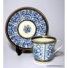 Flight period Worcester 'royal lily' coffee can & saucer Date : c1790 Period : George III Marks : Unmarked Origin : England Colour : White & blue Pattern : 'Royal lily' Features : Tapered coffee can with a kicked handle. Gilded detailing to the handle and bordering bands, recess to the saucer.