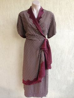 This is a stunning dress and a very rare find! Original 1940s WW2 wrap style polka dot dress. Gorgeous Burgundy/ Wine coloured dress with a