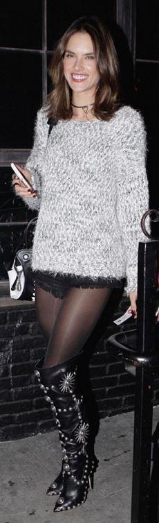 Who made  Alessandra Ambrosio's black denim shorts, gray sweater, handbag, and white print handbag?