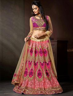 Amass compliments wherever you go dressed in this grambling hot pink net designer lehenga choli, this designer lehenga choli decorated with booti work, heavy embroidery, lace border, patch border work, resham embroidery, stone work and zardosi work.