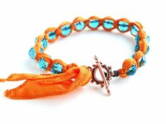 Art Bead Scene Blog: Square Knot Bracelet Tutorial using fabric (maybe even old t-shirts!) Love this color combo!