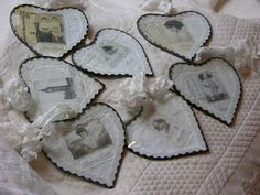 Soldered, heart-shaped fabric collages, created with vintage laces, hankies, and photos