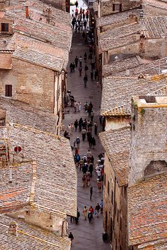 Over the Streets Via san Giovanni, the main street that comes into San Giminiano Italy