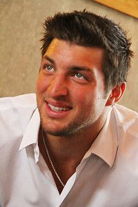 Tim Tebow - The only man on the face of the earth that could even make me consider being a gator fan. Hotness!!! ;)