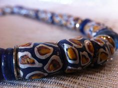 African Glass necklace by monuandmonu on Etsy Handmade Beaded Jewelry, Handmade Necklaces, Orange Design, Silver Accessories, Glass Necklace, Blue Beads, Glass Beads, Beaded Bracelets, Blue And White