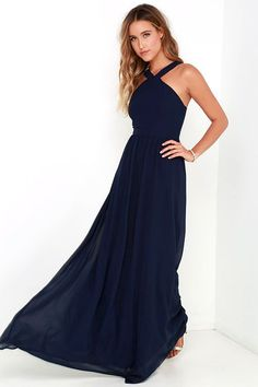 More romantic than a candlelit dinner or a trip to the Eiffel Tower, the Air of Romance Navy Blue Maxi Dress will have you feeling the love! Lightweight Georgette falls from a modified halter neckline, into a seamed bodice supported by semi-sheer shoulder straps. A sweeping skirt cascades from a banded waist completing this elegant maxi dress. Hidden zipper with clasp.