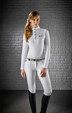 Woman competition long sleeve polo shirt made of extremely breathable and elastic fabric. Fitted model. The fabric guarantees the highest comfort in the movements with a coolness sensation during the