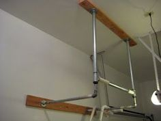 Constantly Varied: CrossFit Garage Gym: DIY Pull Up Bar Good idea for garage storage. Homemade Pull Up Bar, Diy Pull Up Bar, Diy Bar, Diy Gym Equipment, No Equipment Workout, Fitness Equipment, Training Equipment, Workout Gear, Garage Pull Up Bar