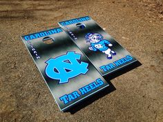 A sweet UNC Cornhole board set! www.bklboards.com. I WANT!!! I can make corn hole boards but these are beautiful!