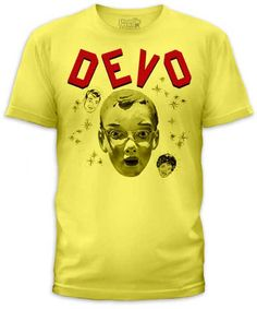 c754dca3 Devo- Mask on a yellow ringspun cotton shirt by Goodie Two Sleeves