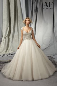 Angelina Faccenda by Mori Lee wedding dress. Ballgown with heavily beaded bodice and cap sleeves. Fairytale wedding dress.