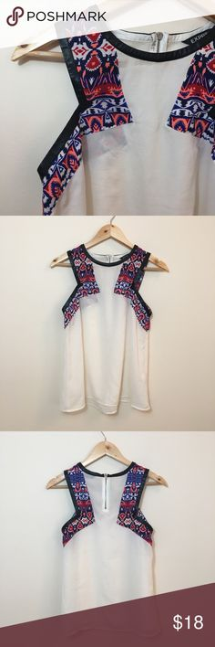 """Express Sleeveless  Tribal Sheer Blouse Express sleeveless tribal print, faux leather lining, sheer blouse in size small.   100% polyester  Chest: 33.5"""" Length: 25"""" Express Tops Blouses"""