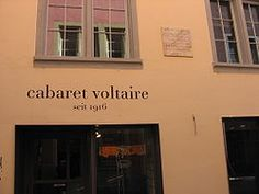 Cabaret Voltaire was a nightclub in Zurich, Switzerland, founded by Hugo Ball & Emmy Hennings on February 5, 1916 as a cabaret for artistic and political purposes. Other founding members were Marcel Janco, Richard Huelsenbeck, Tristan Tzara, and Jean Arp. Events at the cabaret proved pivotal in the founding of the anarchic art movement known as Dada. The young artists of Zurich are invited to come along with suggestions and contributions of all kinds. -Zurich, February 2, 1916 (if only...)