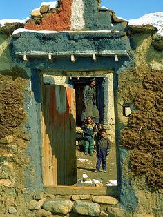Tibetan family at their front door