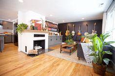 Boise Boys | Timber And Love | Luke Caldwell | HGTV | Realty | Mid Century modern | home renovation | Design | Boise Idaho | white fireplace | plants | wood floors | black wall | guitar wall