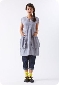 The Rose Dress is handmade by Rebe from cotton navy gingham. This sundress slips over the head and ties in the back, making it an easy fit. It features two bucket pockets and is lovely worn alone or layered over a t-shirt, pants, or a skirt.