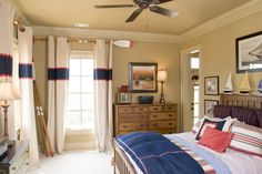 Lake house boys bedroom, Window treatments hang from large wooden oars. The room is complete with a boating theme., Boys Rooms Design