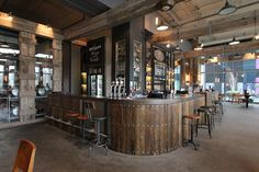 Using individually stained reclaimed scaffolding planks makes for a beautiful bar. The surface is crafted from solid oak which was sanded and coated in resin to give a wonderful texture. Bar Design by Lomax Interiors http://www.lomaxinteriors.com/