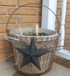 I found this rusty egg basket at a garage sale, brought it home, added some twigs and a star (along with some potted flowers), and placed outside. :)