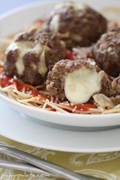 Mozzarella Stuffed Homemade Meatballs - Picky Palate  These are so easy and so delicious!!