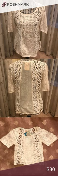 Anthropologie ivory lace blouse new with tags sz L Beautiful ivory lace blouse by Anthropologie, new wit tags, size large. Timeless appeal to enjoy dressing up or dressing down. Thanks for shopping!💕 Anthropologie Tops Blouses