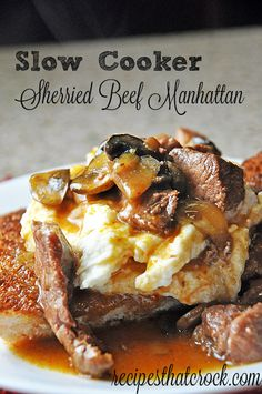 Slow Cooker Sherried Beef Manhattan. Flavorful beef and mushrooms on a bed of creamy mashed potatoes atop a toasted piece of French bread… delish!