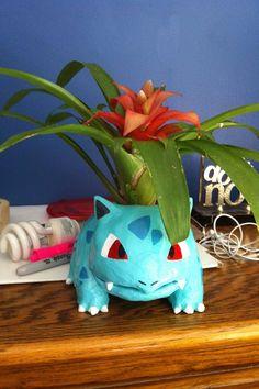 Ivysaur pot!! Take terra cotta pot, paper-mâché around, paint, put in plant :)