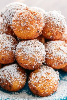 Billowy soft and lightly sweet Donut Holes (Russian Ponchiki). These donut holes are made with cheese giving them unforgettable flavor. Easy donut recipe!
