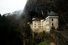 The Cliff-hanging Castle at the Mouth of a Hidden Cave Network (Messy Nessy Chic) Time Travel, Places To Travel, Places To See, Messy Nessy Chic, French Castles, Slim Aarons, Cliff, The Good Place, Wanderlust