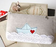 Cute pencilcase or mini bag... love the lace and boat application on it!