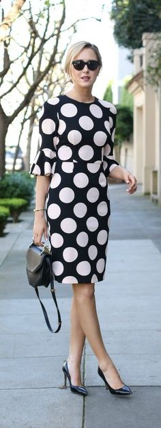 black and light pink polka dot bell-sleeve dress, black pointed toe pumps, black handbag, cat eye sunglasses   messy bun asos, sjp collection, m2malletier, warby parker