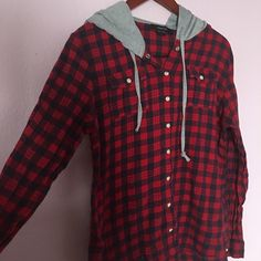 Red hooded button down flannel Red flannel// Button down// no button on right sleeve has a few snags of thread but otherwise in decent condition Tops Button Down Shirts