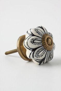 """Caricature Knob - anthropologie.com Details  Tighten with care No additional hardware required Ceramic, brass 1.75"""" diameter 1.25"""" projection 1.75"""" bolt can be trimmed to size Imported Style #: 974140 $8"""