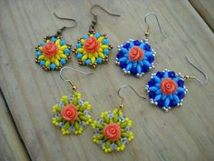 Small beaded earrings with superduos and rose coral by thiosart, $8.00