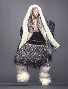 Lower half silhouette - big fur boots and skirt of textural layered yarns------------------  visual optimism; emily baker by ishi for vogue netherlands november 2014