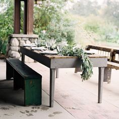 Rustic Greenery Table Runner. This sweet, rustic table runner is ideal for a casual outdoor reception. Combine tons of greenery with white floral accents for a naturally gorgeous display.