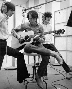 "David Jones and Micky Dolenz provide vocals as Mike Nesmith plays his Guild 12-string guitar at a Monkees recording session at RCA Studios, January 1969. It looks like the setup for ""Nine Times Blue."""