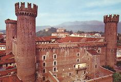 Castello di Ivrea, in Torino, Piemonte, Italy | Castle built in 1358 at the behest of Conte Verde, Amadeo VI of Savoy, as a symbol of Savoy's dominion over Ivrea and Canavese. Four massive circular towers characterise the structure, located next to the cathedral and the bishop's palace. http://www.winepassitaly.it/index.php/en/travel-wineries-piedmont/maps-and-wine-zones/torinese/itinerary/the-road-of-three-glasses#!prettyPhoto