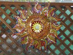"27"" diameter Sunburst. 1/4"" cut glass pieces, tempered glass over oil painted swirls with Crystal door knob in center Crystal Door Knobs, Glass Door Knobs, Mosaic Art, Mosaics, Shattered Dreams, Mosaic Ideas, Cut Glass, Swirls, Bling"