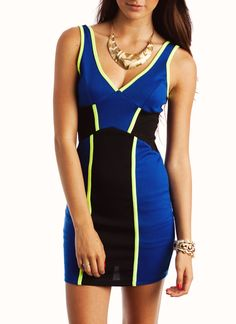 A bold pattern and pops of color mean that this stretchy dress will flatter your curves.