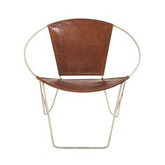 With a frame like a lasso stuck in time, this Western-inspired leather chair presents an elegant, rounded construction of quality metal that will add a charming look to your room. We love this chair in...  Find the Lasso Leather Chair, as seen in the The Modern Outdoorsman Collection at http://dotandbo.com/collections/the-modern-outdoorsman?utm_source=pinterest&utm_medium=organic&db_sku=94765