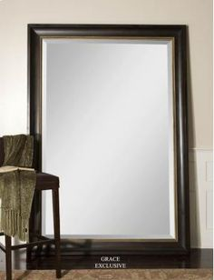 This stately, oversized mirror features a dark mahogany wood tone finish with an antiqued champagne liner. Mirror has a generous 1 bevel. 58 W X 82 H X 3 D (in) UHW - Unique Furnishings For Home & Patio Black Wall Mirror, Round Wall Mirror, Wall Mounted Mirror, Mirror Mirror, Entry Mirror, Extra Large Wall Mirrors, Big Mirrors, Uttermost Mirrors, Leaner Mirror