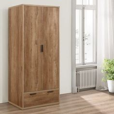 A charming addition to virtually any bedroom, the Stockwell Rustic Oak Wooden 2 Door Combination Wardrobe grants both traditional and modern homes an abundance of storage space and contemporary style. As the combination in the name suggests, the Stockw Room Door Design, House Design, Diy Sliding Door, Front Door Handles, Door Makeover, Hanging Rail, Room Doors, Storage Spaces, Tall Cabinet Storage